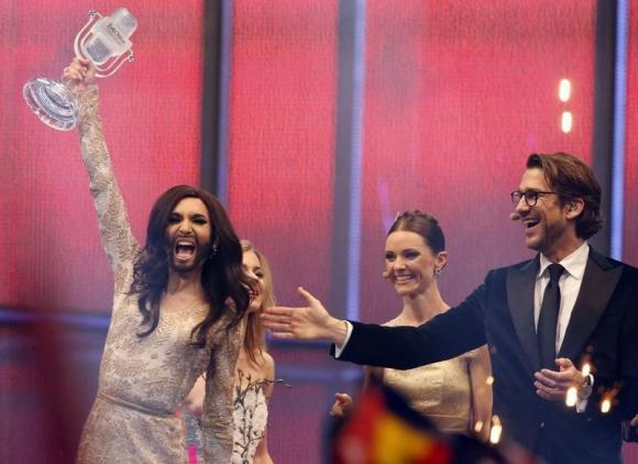 Conchita Wurst representing Austria celebrates after winning the grand final of the 59th Eurovision Song Contest in Copenhagen